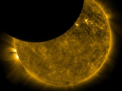 Sun and moon from SDO